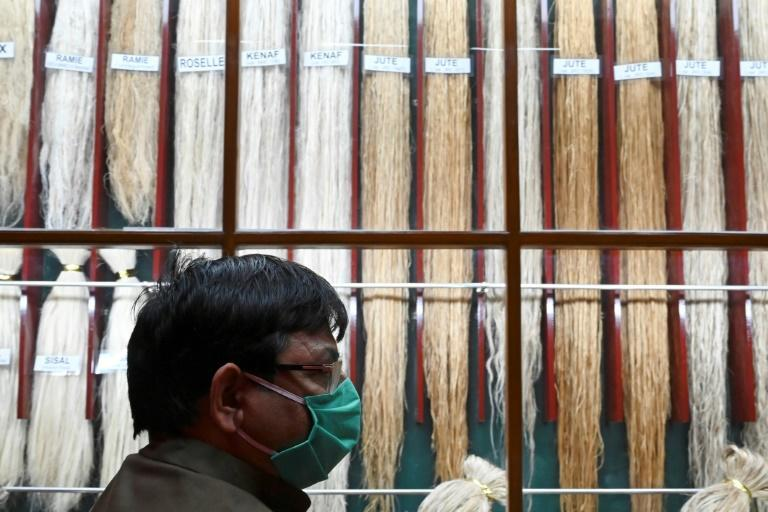 Today, India is trying to promote jute as a fabric for a sustainable future, with the government issuing a mandate that all foodgrains and 20 percent of sugar should be packed in jute sacks (AFP/Dibyangshu SARKAR)