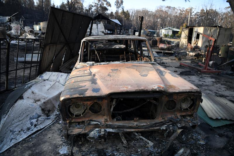 A burnt-out car in a Torrington property destroyed by a NSW bushfire near Glen Innes on Sunday.
