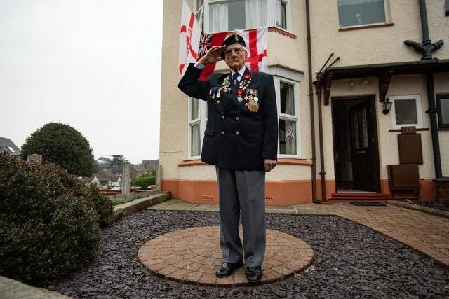 Merchant Navy veteran Bill Bennett, 94, wears his medals whilst at his home in Kidderminster, during the two-minute silence