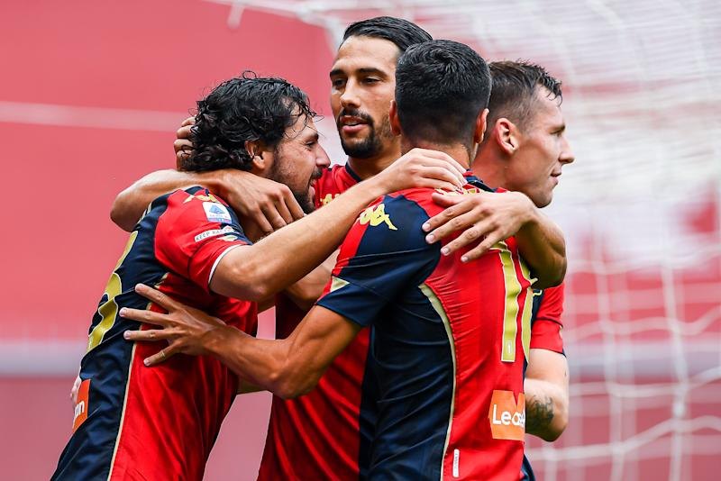 GENOA, ITALY - SEPTEMBER 20: Mattia Destro of Genoa (left) celebrates with his team-mates Edoardo Goldaniga, Paolo Ghiglione and Lukas Lerager after scoring a goal during the Serie A match between Genoa CFC and Fc Crotone at Stadio Luigi Ferraris on September 20, 2020 in Genoa, Italy. (Photo by Paolo Rattini/Getty Images)
