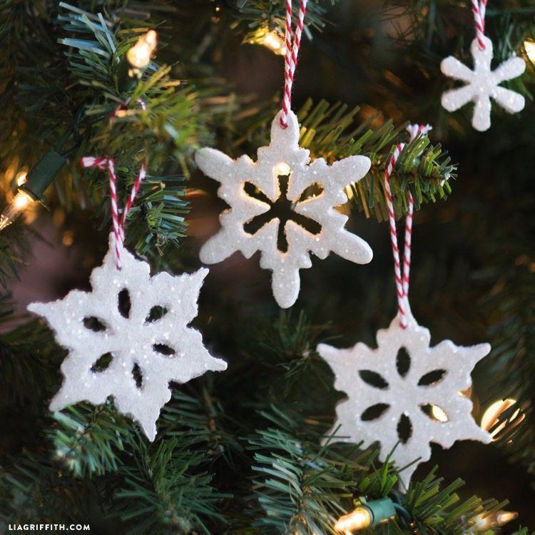 """<p>These pretty, glittery snowflakes require just a few simple crafting tools. Make a bunch to brighten up your entire tree or <a href=""""https://www.countryliving.com/home-design/decorating-ideas/g1571/holiday-mantels/"""" rel=""""nofollow noopener"""" target=""""_blank"""" data-ylk=""""slk:mantel"""" class=""""link rapid-noclick-resp"""">mantel</a>! </p><p><strong>Get the tutorial at <a href=""""https://liagriffith.com/clay-snowflake-ornaments/"""" rel=""""nofollow noopener"""" target=""""_blank"""" data-ylk=""""slk:Lia Griffith"""" class=""""link rapid-noclick-resp"""">Lia Griffith</a>. </strong></p><p><a class=""""link rapid-noclick-resp"""" href=""""https://www.amazon.com/International-1894-Snowflake-Cutters-Assorted/dp/B000PGSKUQ/?tag=syn-yahoo-20&ascsubtag=%5Bartid%7C10050.g.28831556%5Bsrc%7Cyahoo-us"""" rel=""""nofollow noopener"""" target=""""_blank"""" data-ylk=""""slk:SHOP SNOWFLAKE COOKIE CUTTERS"""">SHOP SNOWFLAKE COOKIE CUTTERS</a></p>"""