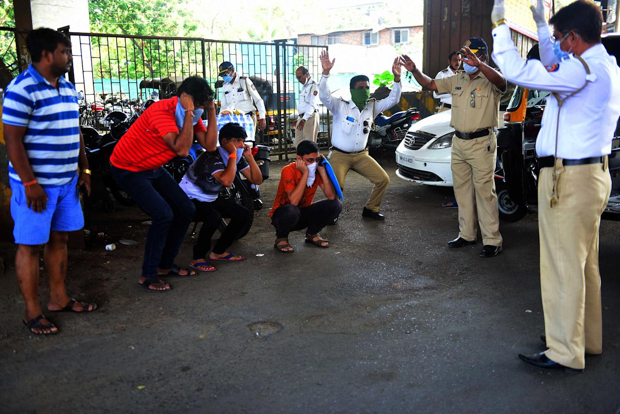 MUMBAI, INDIA - MARCH 31: Police punishes people who fail to explain why they are roaming out during Nakabandi at Vakola signal, Santacruz during Lockdown due to Corona virus , on March 31, 2020 in Mumbai, India. (Photo by Vijayanand Gupta/Hindustan Times via Getty Images)