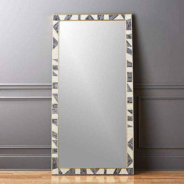 """This rectangular floor mirror is anything but basic. Gray and white bone create a geometric mosaic inside a shiny brass frame surrounding a six-foot-tall mirror. It looks like a piece of art on its own and adds a gorgeous texture to your walls. $699, CB2. <a href=""""https://www.cb2.com/grace-bone-inlay-floor-mirror/s375921?localedetail=US"""" rel=""""nofollow noopener"""" target=""""_blank"""" data-ylk=""""slk:Get it now!"""" class=""""link rapid-noclick-resp"""">Get it now!</a>"""