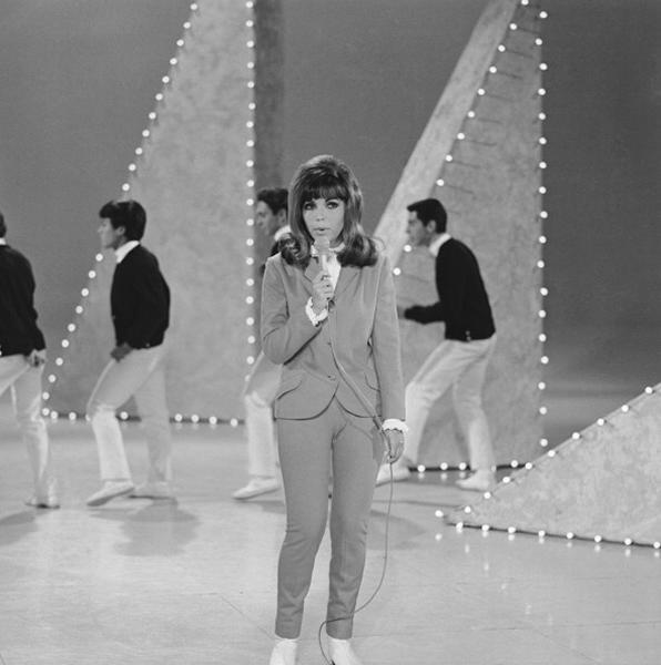 """<div class=""""caption-credit""""> Photo by: Fred Hermansky/NBC/NBCU Photo Bank via Getty Image</div><b>Performing on Hullabaloo, a prime time variety show, in 1965</b> <br> We forgot how cute Nancy looked as a brunette! Here she is in another adorable suit. The slightly cropped pants are key. <br>"""