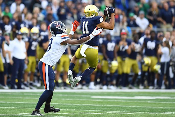 Notre Dame safety Alohi Gilman intercepts a pass intended for Virginia's Hasise Dubois.