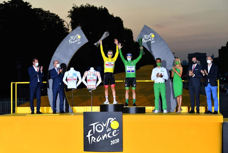 PARIS FRANCE SEPTEMBER 20 Podium Tadej Pogacar of Slovenia and UAE Team Emirates Yellow Leader Jersey White Best Young Rider Jersey and Polka Dot Mountain Jersey Sam Bennett of Ireland and Team Deceuninck QuickStep Green Points Jersey Celebration Trophy during the 107th Tour de France 2020 Stage 21 a 122km stage from MantesLaJolie to Paris Champslyses TDF2020 LeTour on September 20 2020 in Paris France Photo by Stuart FranklinGetty Images