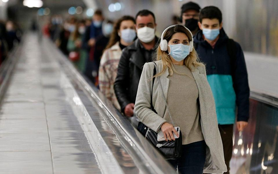 Masks prevent emissions but also store droplets and aerosols and could be a source of infection - Getty Images Europe