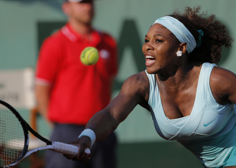 USA's Serena Williams returns the ball to France's Virginie Razzano during their first round match in the French Open tennis tournament at the Roland Garros stadium in Paris, Tuesday, May 29, 2012. (AP Photo/Christophe Ena)