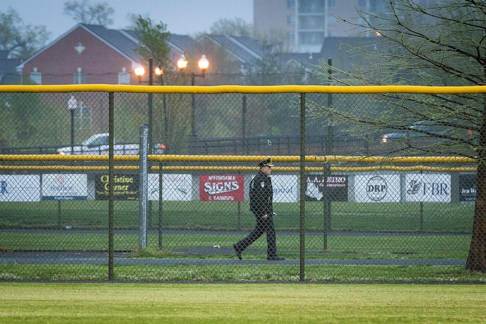 <p>A Capitol Police officer walks the perimeter of the field as members of the Republican Congressional Baseball Team hold practice at Simpson Field on 25 April 2018 in Alexandria, Virginia. The practice was the first time the members of Congress have returned to the scene of last year's shooting where House Majority Whip Rep. Steve Scalise (R-La.), and four others, including two Capitol Police officers, were wounded when a gunman opened fire on 14 June 2017.  </p> ((Photo by Pete Marovich/Getty Images))