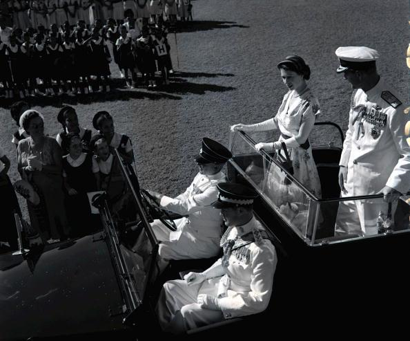 Royal Tour of Jamaica, December, 1953, Her Majesty Queen Elizabeth II and Prince Philip, the Duke of Edinburgh drive around Sabina Park, home of the Jamaican cricket team, to review 20, 000 schoolchildren during their visit to the Caribbean Island  (Photo by Popperfoto/Getty Images)