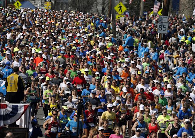 Runners compete near the start of the 118th Boston Marathon Monday, April 21, 2014 in Hopkinton, Mass. (AP Photo/Michael Dwyer)