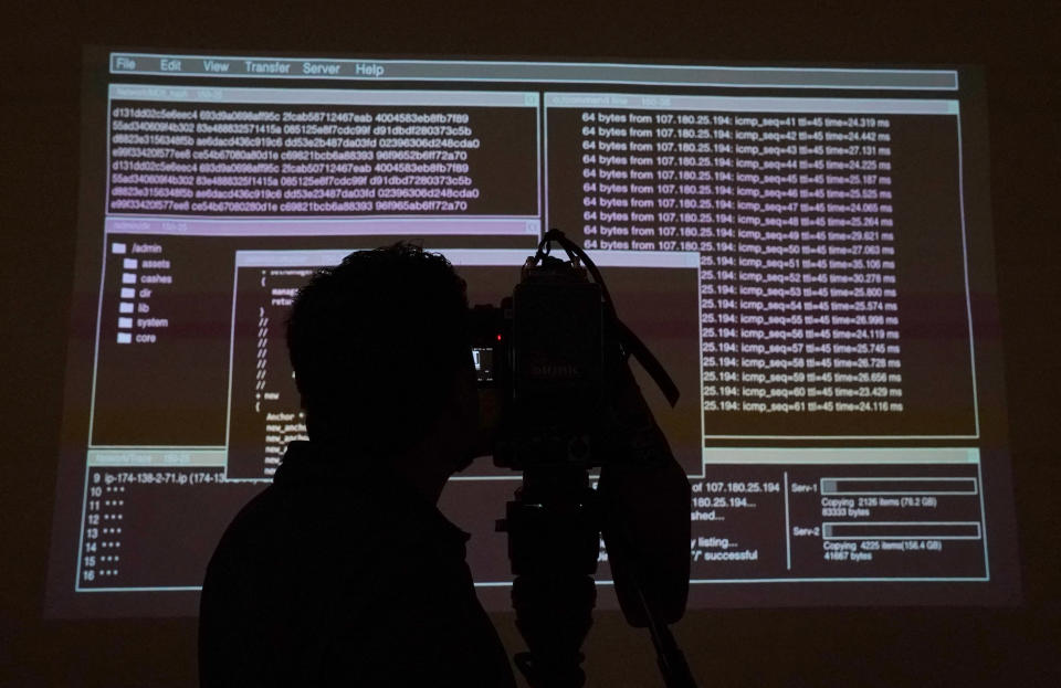 A videographer films a projection of source code during a media preview at Sotheby's on June 24, 2021, in New York, for Sotheby's NFT Auction of Sir Tim Berners-Lee