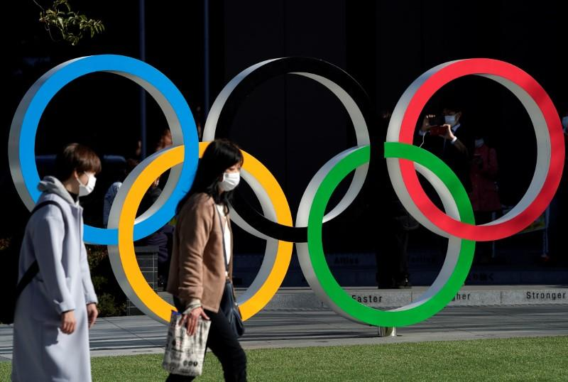 Japan's economy minister says Olympic postponement to push back trillions of yen in demand