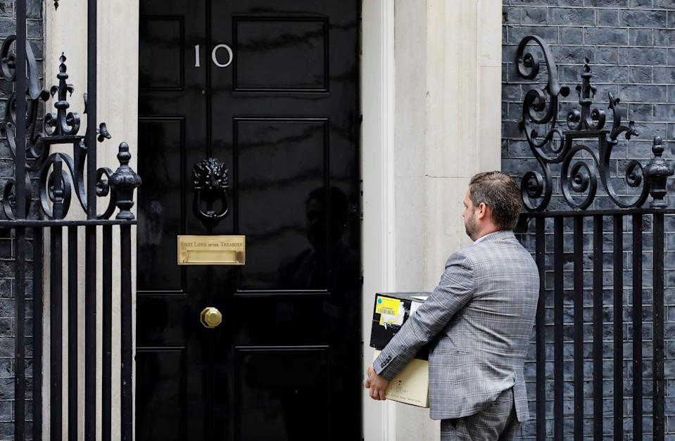 """A man carries a box of Dom Perignon champagne as he makes a delivery to 10 Downing Street, the official residence of Britain's Prime Minister, in central London on April 29, 2020. - British Prime Minister Boris Johnson's partner Carrie Symonds on Wednesday gave birth to a """"healthy baby boy"""" in a London hospital, a spokesman for the couple said. The news came as a surprise, as Symonds, 32, was not thought to be due for several weeks, but she was said to be doing """"very well"""". The birth comes just days after Johnson, 55, returned to work after being admitted to hospital with coronavirus, including three nights in intensive care. (Photo by Tolga AKMEN / AFP) (Photo by TOLGA AKMEN/AFP via Getty Images)"""