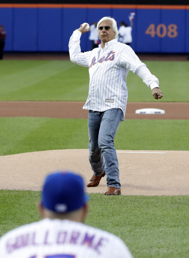 Bob Baffert, the trainer for Justify, throws out the ceremonial first pitch at a baseball game between the New York Mets and the Baltimore Orioles on Tuesday, June 5, 2018, in New York. (AP Photo/Frank Franklin II)