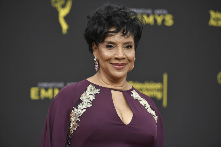 """FILE - In this Sept. 15, 2019, file photo Phylicia Rashad arrives at the Creative Arts Emmy Awards in Los Angeles. Rashad has found herself embroiled in controversy after expressing public support for Bill Cosby's release from prison, with some prominent Black voices calling for her dismissal as dean of the Howard University College of Fine Arts. Rashad played Cosby's wife on """"The Cosby Show"""". It remains to be seen whether Rashad's position at Howard is in jeopardy, but the university quickly distanced itself from her comments. (Photo by Richard Shotwell/Invision/AP, File)"""