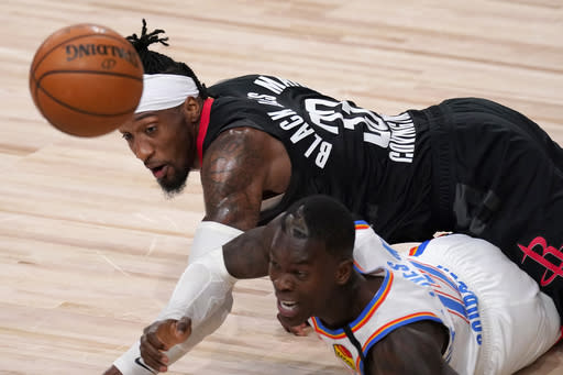 Houston Rockets' Robert Covington, top, and Oklahoma City Thunder's Dennis Schroder, bottom, scramble on the floor for a loose ball during the second half of an NBA first-round playoff basketball game in Lake Buena Vista, Fla., Wednesday, Sept. 2, 2020. (AP Photo/Mark J. Terrill)