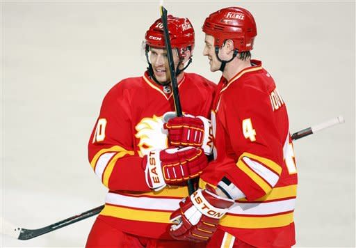 Calgary Flames' Jay Bouwmeester, right, celebrates his goal with teammate Blake Comeau during second period NHL hockey action against the Anaheim Ducks in Calgary, Alberta, Saturday, April 7, 2012. (AP Photo/The Canadian Press, Jeff McIntosh)