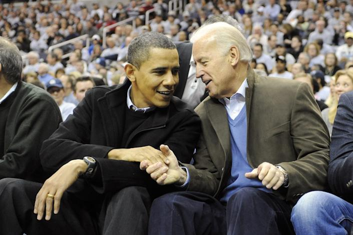 President Barack Obama and Vice President Joe Biden talk during a college basketball game between the Georgetown Hoyas and the Duke Blue Devils on Jan. 30, 2010 at the Verizon Center in Washington, D.C.