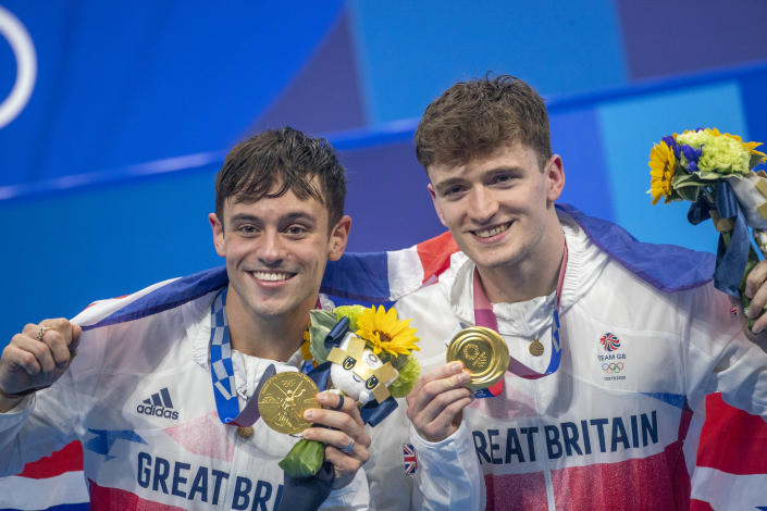 TOKYO, JAPAN - JULY 26: Tom Daley and Matty Lee of Great Britain with their gold medal after victory in the Synchronised 10m Platform Diving for Men  at the Tokyo Aquatic Centre at the Tokyo 2020 Summer Olympic Games on July 26, 2021 in Tokyo, Japan. (Photo by Tim Clayton/Corbis via Getty Images)