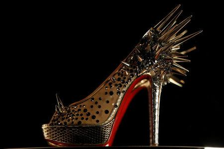 FILE PHOTO: A shoe by French designer Christian Louboutin is seen during a media viewing of his retrospective exhibition at the Design Museum in London April 30, 2012.   REUTERS/Stefan Wermuth/File Photo
