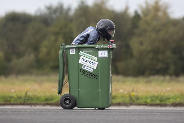 Wacky design engineer sets new Guinness World Record after reaching speeds of over 40mph - in a WHEELIE BIN
