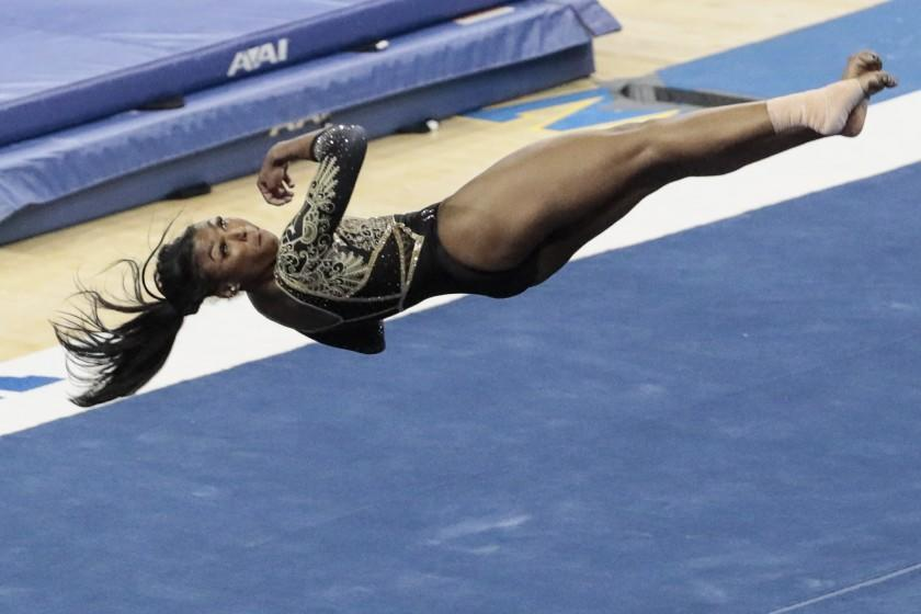 Westwood, CA, Saturday, February 27, 2021 - UCLA gymnast Nia Dennis competes in the floor exercise.