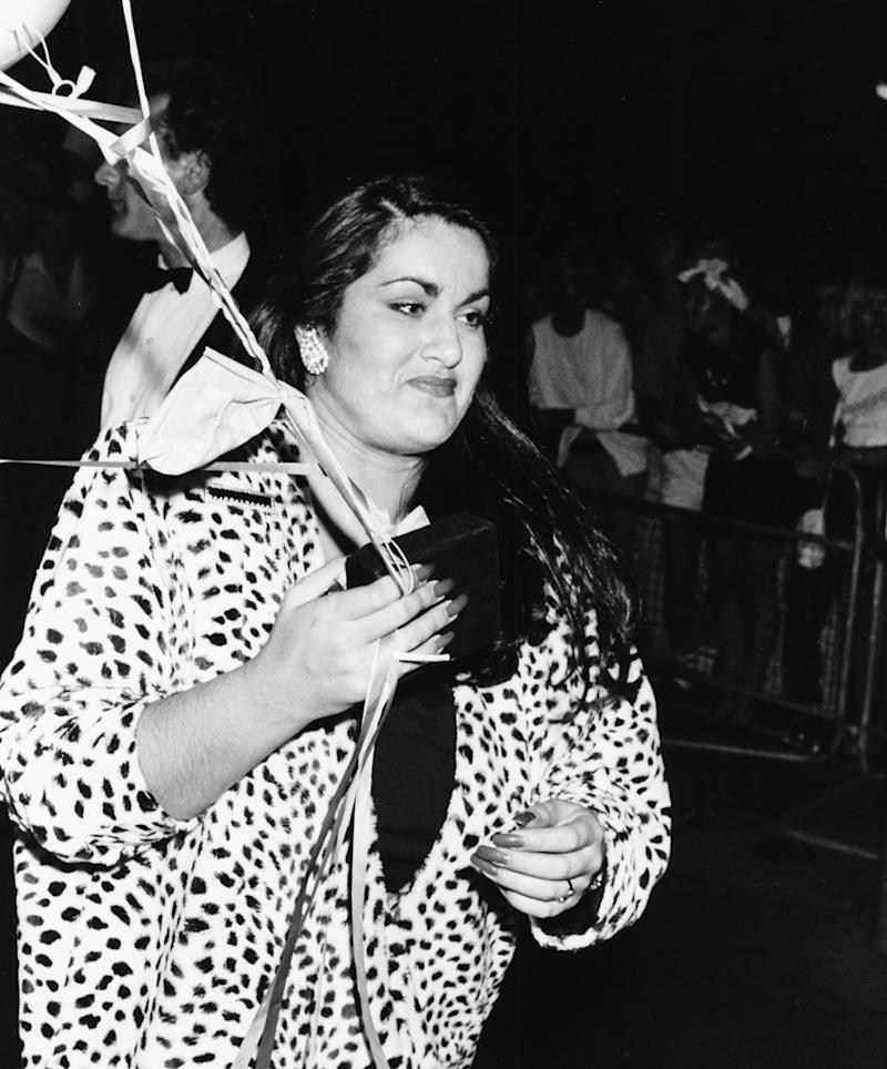 Melanie Panayiotou, sister of singer George Michael, holding balloons as she attends the 'Wham!' farewell party, London, July 8th 1986.