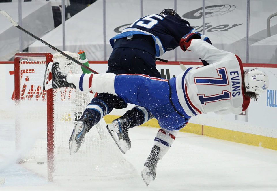 Jets forward Mark Scheifele's controversial hit on Canadiens rookie Jake Evans has predictably yielded a wide spectrum of good and bad takes. (Getty)