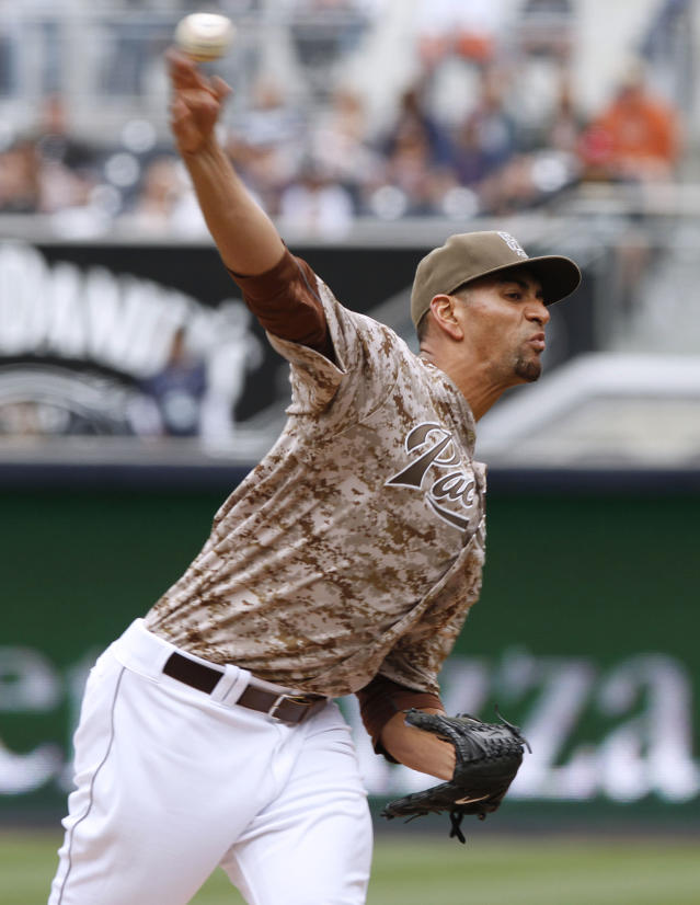 San Diego Padress starting pitcher Tyson Ross pitches in the first inning of a baseball game against the Detroit Tigers Sunday, April 13, 2014, in San Diego. (AP Photo/Don Boomer)