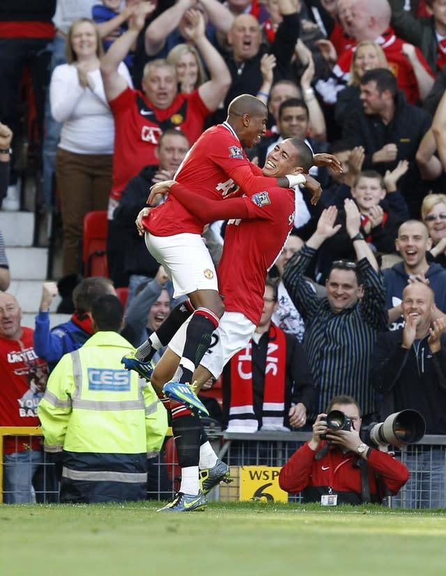 Chris Smalling, right, celebrates his goal against Chelsea (Peter Byrne/PA)