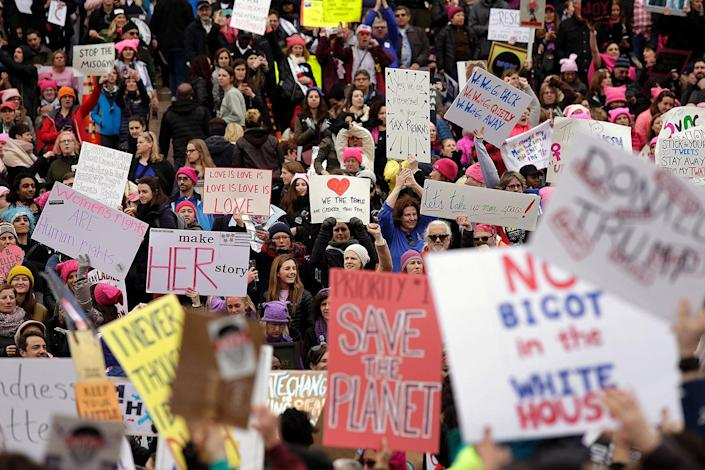 <p>Demonstrators protest during the Women's March on January 21, 2017 in Washington, DC. (JOSHUA LOTT/AFP/Getty Images) </p>