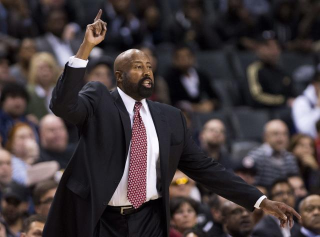 New York Knicks head coach Mike Woodson reacts while playing against the Toronto Raptors during second half NBA pre-season basketball action in Toronto on Monday, Oct. 21, 2013. (AP Photo/The Canadian Press, Nathan Denette)