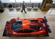 A man looks at a McLaren F-1 LM-Specification car is displayed at Sotheby's in New York June 3, 2015. REUTERS/Brendan McDermid