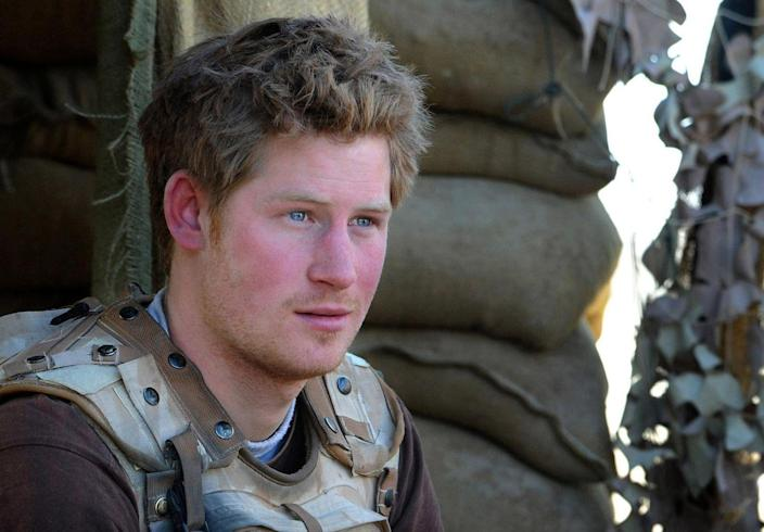 <p>Harry, 24, sits at an observation post in Helmend Province, Afghanistan, during his first tour with British forces. Harry's deployment, the first by a member of the royal family since Prince Andrew (who served in the Falklands War), was cut short after German and Australian tabloids leaked the news of his whereabouts. </p>