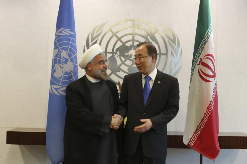 FILE - In this file photo taken Thursday, Sept. 26, 2013, United Nations Secretary-General Ban Ki-moon, right, meets Iranian President Hassan Rouhani at United Nations headquarters. As Iran's diplomatic profile rises with attempts to recalibrate its dealings with Washington, the Gulf rulers will have to make adjustments, too, and that's not such an easy thing for the monarchs and sheiks to swallow. (AP Photo/Mary Altaffer, File)