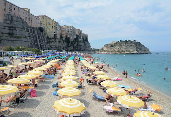 The beautiful beach at Tropea is a hit with Spanish families. (Getty Images)