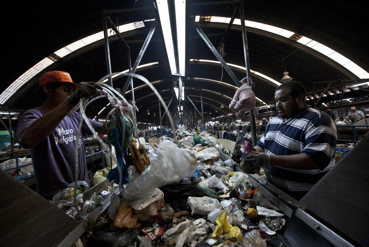 People select garbage to recycle at the landfill Bordo Poniente on the outskirts of Mexico city, Monday, Dec. 19, 2011. Mexico City will close one of the world's largest dumps by Dec. 31 and will instead turn the garbage from millions of people into reusable materials and energy, Mayor Marcelo Ebrard announced Monday. (AP Photo/Christian Palma)