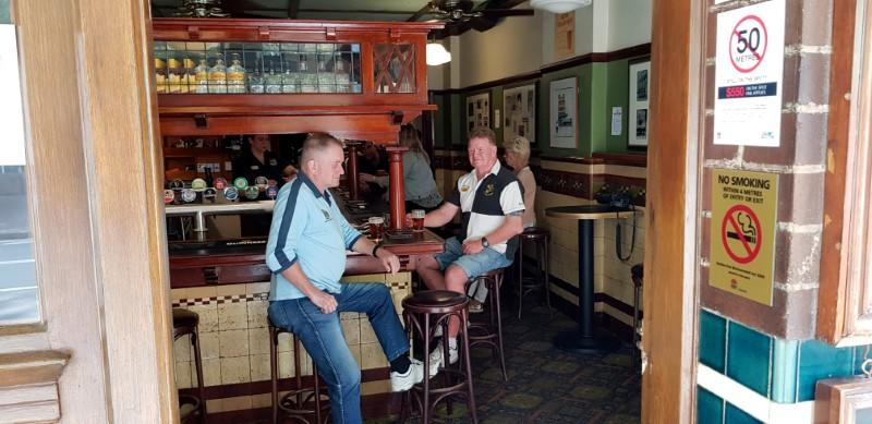 Samo Vojsk and Doug Thomas enjoy a beer in Sydney's Fortune of War pub before its shutdown due to coronavirus concerns, in Sydney
