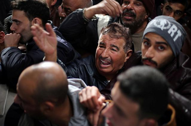 <p>A man gestures as he asks for a travel permit to cross into Egypt through the Rafah border crossing after it was opened by Egyptian authorities for humanitarian cases, in the southern Gaza Strip Feb. 8, 2018. (Photo: Ibraheem Abu Mustafa/Reuters) </p>