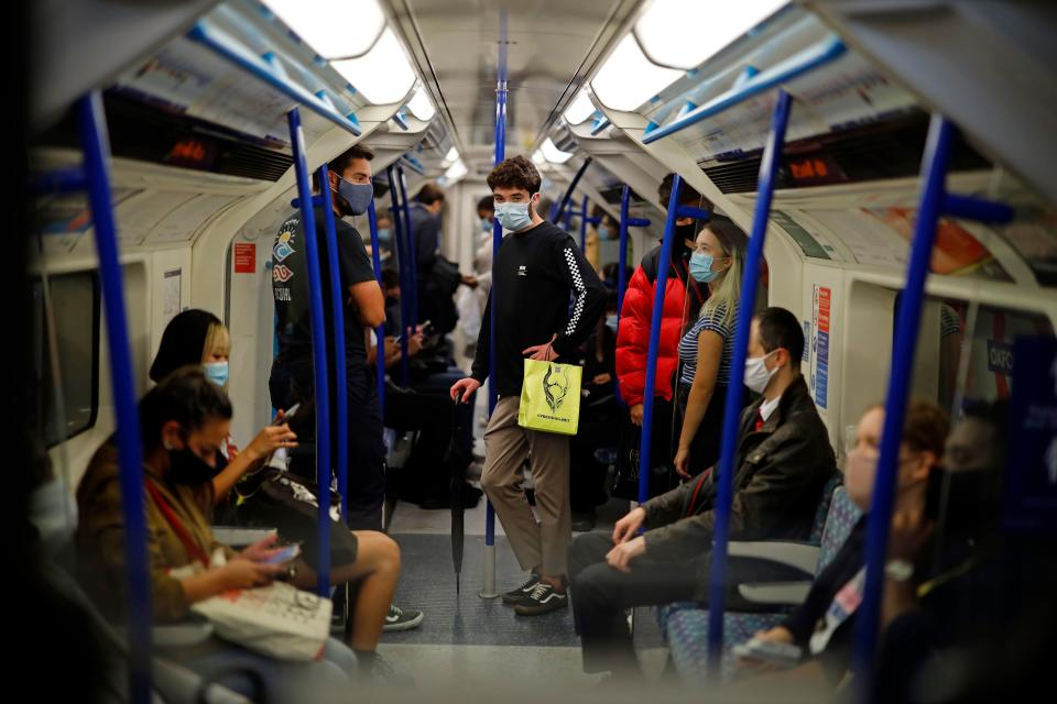 Commuters wearing protective face coverings travel on Victoria line at rush hour in central London on September 23, 2020. - Britain on Tuesday tightened restrictions to stem a surge of coronavirus cases, ordering pubs to close early and advising people to go back to working from home to prevent a second national lockdown. (Photo by Tolga Akmen / AFP) (Photo by TOLGA AKMEN/AFP via Getty Images)