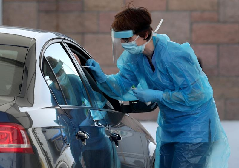 A nurse takes a sample at a COVID 19 testing centre in the car park of the Bowhouse Community Centre in Grangemouth as the UK continues in lockdown to help curb the spread of the coronavirus. (Photo by Andrew Milligan/PA Images via Getty Images)