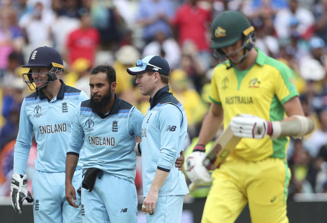 England's Adil Rashid, second left, celebrates with teammates the dismissal of Australia's Pat Cummins, right, during the Cricket World Cup semi-final match between England and Australia at Edgbaston in Birmingham, England, Thursday, July 11, 2019. (AP Photo/Aijaz Rahi)