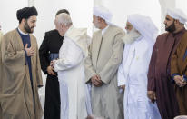 Pope Francis,, second from left, is seen of at the end of an interreligious meeting near the archaeological area of the Sumerian city-state of Ur, 20 kilometers south-west of Nasiriyah, Iraq, Saturday, March 6, 2021. Ur is considered the traditional birthplace of Abraham, the prophet common to Muslims, Christians and Jews.Francis traveled to the southern ruins of Ur on Saturday to reinforce his message of interreligious tolerance and fraternity during the first-ever papal visit to Iraq, a country riven by religious and ethnic divisions. (AP Photo/Andrew Medichini)