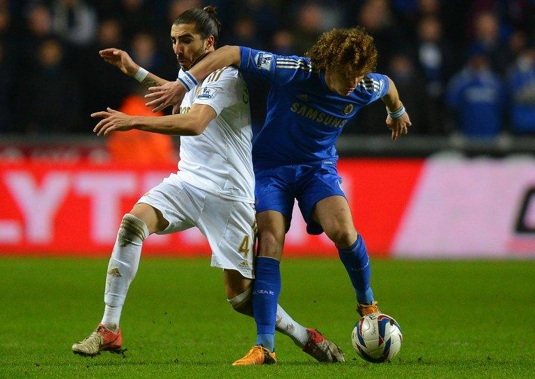 Swansea defender Chico Flores (left) and Chelsea's David Luiz at The Liberty stadium in Cardiff, January 23, 2013