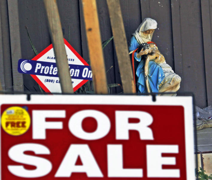 "A religious statuette is displayed with a ""For Sale"" sign on the front porch of the home of Nakoula Basseley Nakoula, the man who made the film ""Innocence of Muslims"" that has sparked violent protests, on a street in Cerritos, Calif., Tuesday, Sept. 25, 2012. The filmmaker has received death threats and was forced into hiding after the 14-minute movie trailer rose to prominence. (AP Photo/Reed Saxon)"