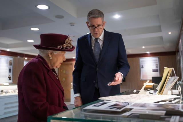 Lord Parker shows the Queen artefacts relating to MI5's D-Day operations during her visit to the intelligence agency. Victoria Jones/PA Wire