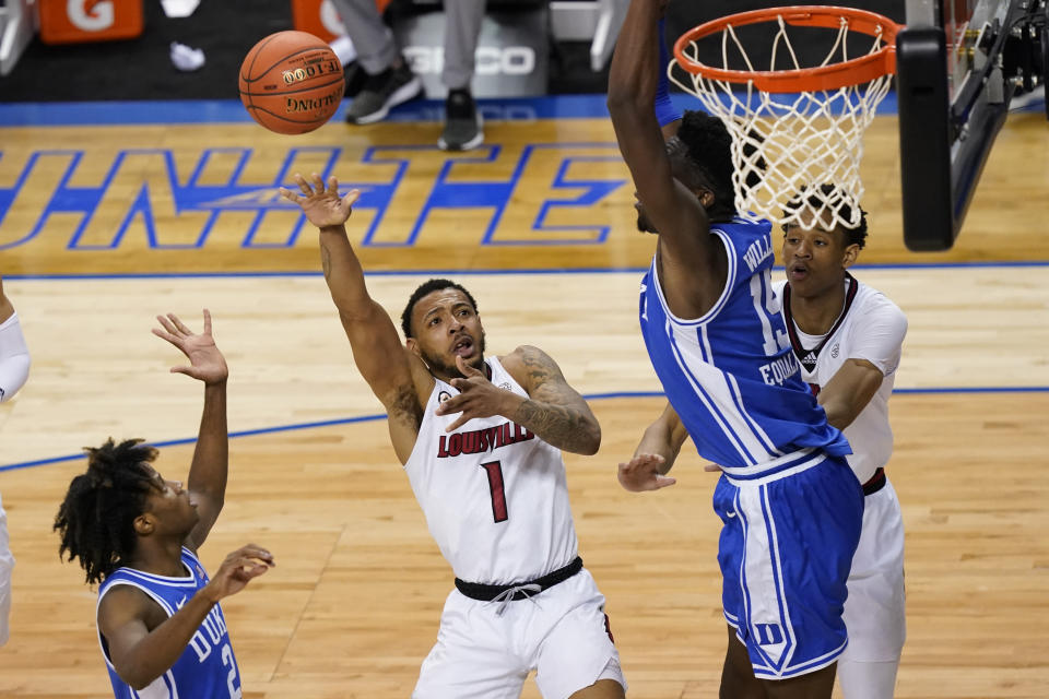 Louisville guard Carlik Jones (1) goes up for a shot as Duke guard DJ Steward (2) and teammate center Mark Williams (15) defend during the second half of an NCAA college basketball game in the second round of the Atlantic Coast Conference tournament in Greensboro, N.C., Wednesday, March 10, 2021. (AP Photo/Gerry Broome)