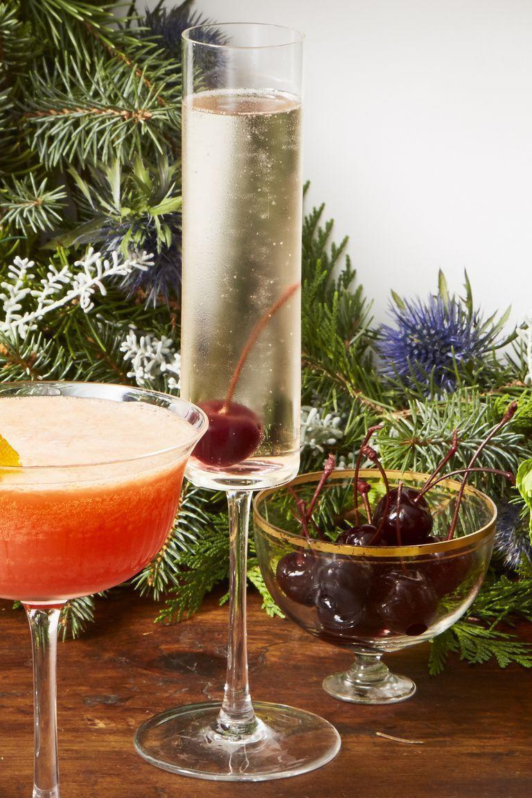 """<p>Ch-ch-ch-cherry bomb! Celebrate fall with a champagne-ready cocktail that's deliciously fruity and fizzy.<br><br><em><a href=""""https://www.goodhousekeeping.com/food-recipes/g29833730/best-champagne-cocktails/?slide=1"""" rel=""""nofollow noopener"""" target=""""_blank"""" data-ylk=""""slk:Get the recipe for Cherry Bomb Fizz »"""" class=""""link rapid-noclick-resp"""">Get the recipe for Cherry Bomb Fizz »</a></em><br></p>"""