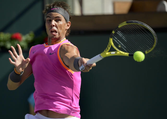 Rafael Nadal, of Spain, misplays a shot from Karen Khachanov, of Russia, and loses the point at the BNP Paribas Open tennis tournament Friday, March 15, 2019, in Indian Wells, Calif. (AP Photo/Mark J. Terrill)